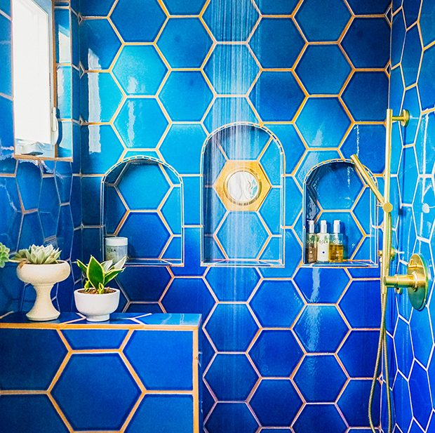 jungalow-bathroom-shower-blue-tile-gold-hardware