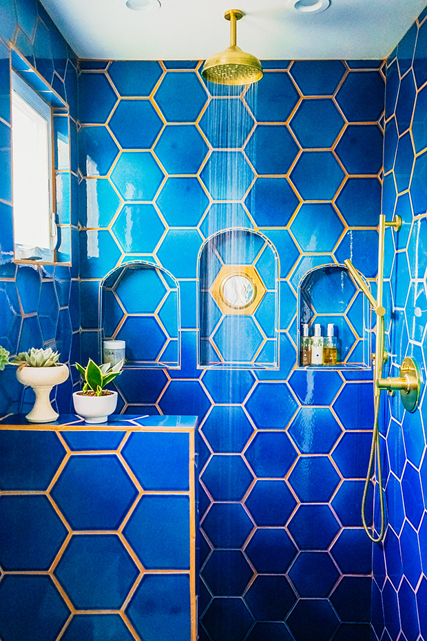 jungalow-bathroom-shower-blue-tile-gold-hardware